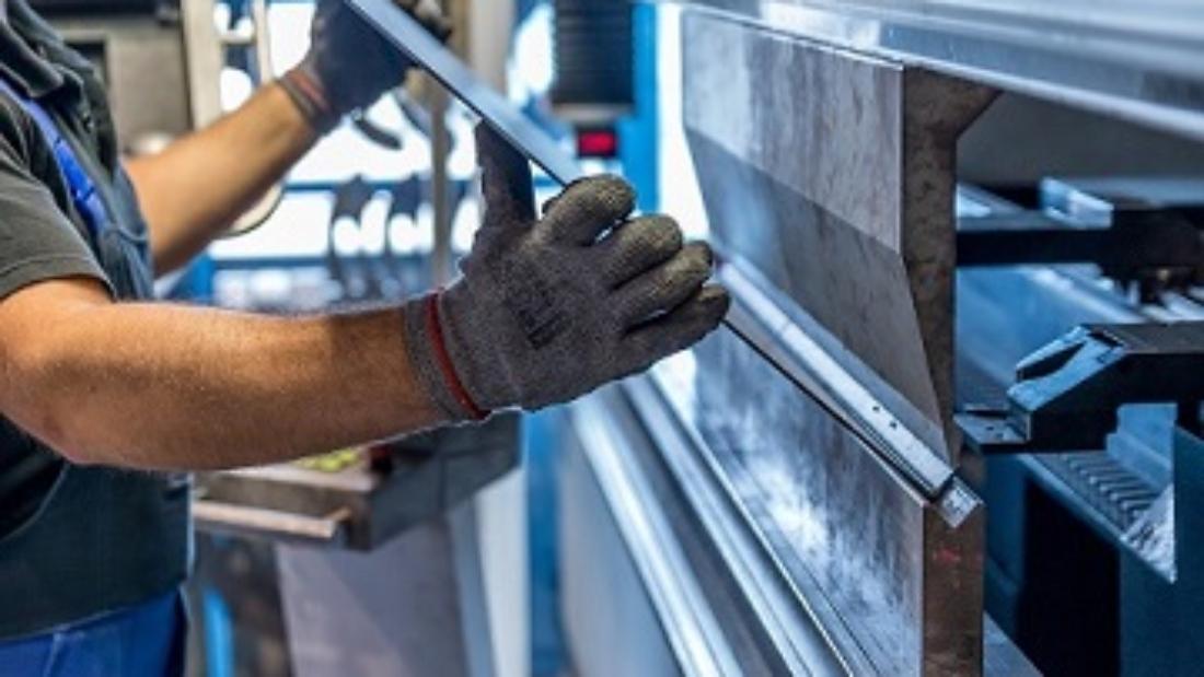 Operator bending sheet metal part using press bending Machine